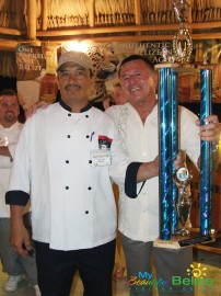 Minister of Tourism Hon. Manuel Heredia Jr presents Chef Vic with the 2009 Taste of Belize BTB award.